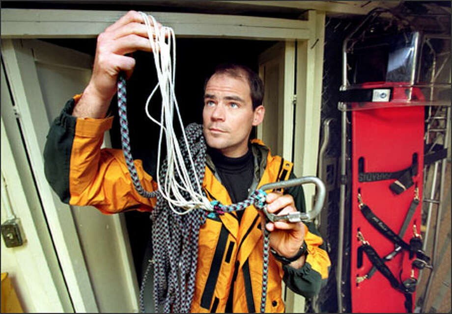 In this 1998 photo, lead climbing ranger Mike Gauthier talks about the dangers of climbing Mount Rainier while holding a frayed rope. Photo: / Seattle Post-Intelligencer