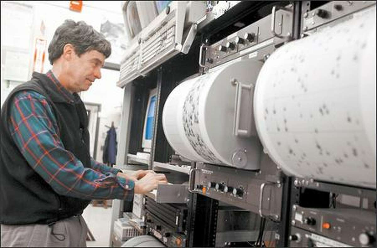 Steve Malone checks a seismograph at the University of Washington recently. In 1980, he was the first to recognize Mount St. Helens' awakening.