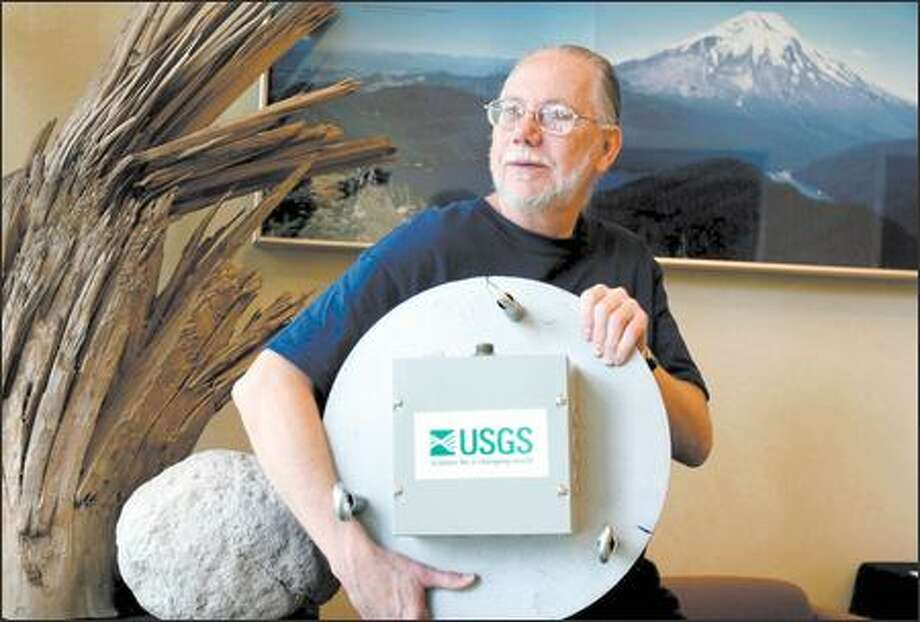 """Marv Couchman shows off the """"Marv Lander,"""" a device that he and fellow scientists cobbled together for the study of Mount St. Helens. Photo: TIM LABARGE"""