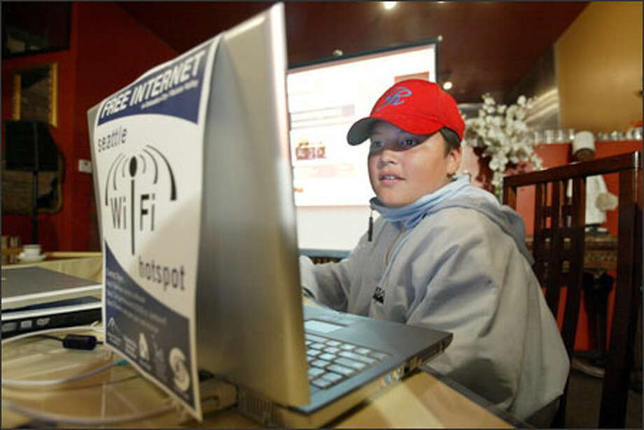Ricky Galdez, 12, wasn't shy about jumping on the Internet as the city launched the service at a restaurant in Columbia City yesterday. Photo: Scott Eklund/Seattle Post-Intelligencer