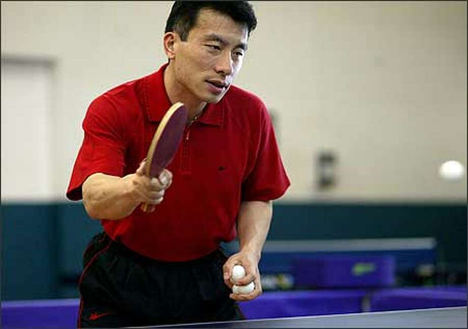 Yiyong Fan, who was the No. 1 ranked player in the U.S. for five years, opens Washington's first dedicated pingpong facility tomorrow in Bellevue. Photo: Joshua Trujillo/Seattle Post-Intelligencer