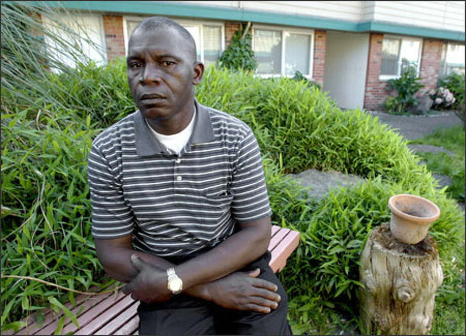 Boley Tolo sits outside his family's apartment in Tukwila. In Liberia, Tolo was a government health official. Now he hauls furniture in Renton. Photo: Gilbert W. Arias/Seattle Post-Intelligencer / SEATTLE POST- INTELLIGENCER