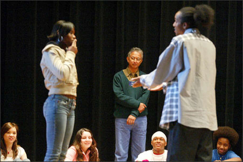 Street theater coach C.Y. Gopinath, standing center, directs Cleveland High School students Kanesha Henderson, standing left, and Denzell Davis, standing right, in a skit about the health effects of smoking. Photo: Paul Joseph Brown/Seattle Post-Intelligencer