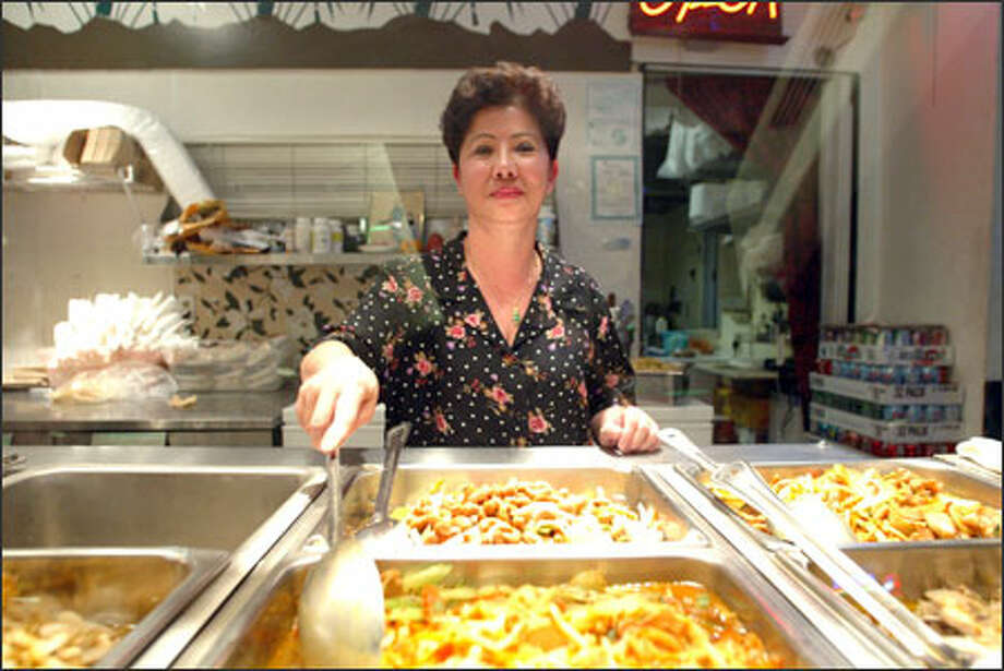 Chau Tran, owner of the Viet My restaurant, has been ordered out of the Bank of America food court by its corporate landlord. Photo: Gilbert W. Arias/Seattle Post-Intelligencer / SEATTLE POST- INTELLIGENCER