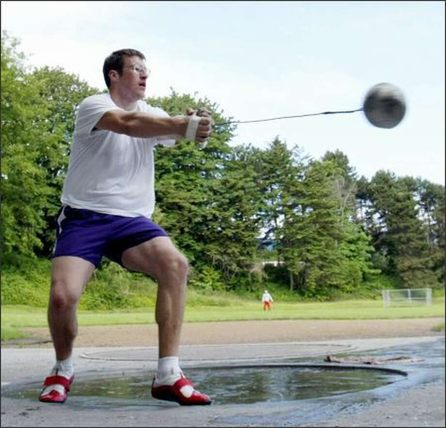 UW hammer thrower Martin Bingisser, on schedule to graduate with two years of eligibility remaining, works out in preparation for the NCAA West Regional. Photo: MERYL SCHENKER/P-I