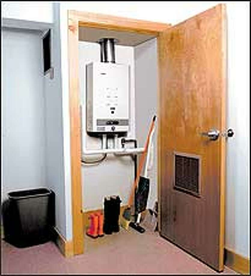 A whole-house tankless water heater can be mounted in a closet. Photo: CEC