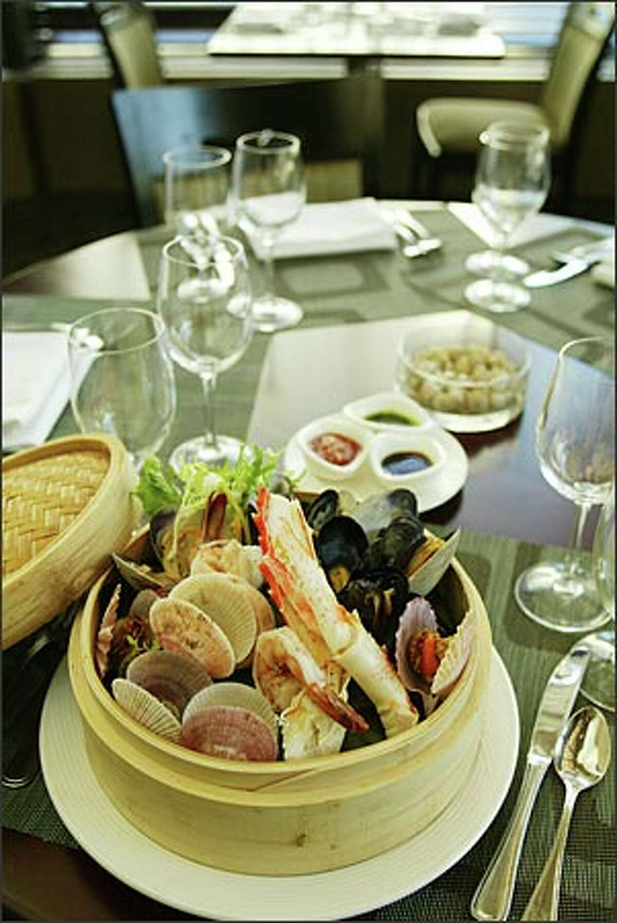 Visit Coldwater for the top neck clams, offered in several dishes, including this steamed basket of Northwest shellfish.