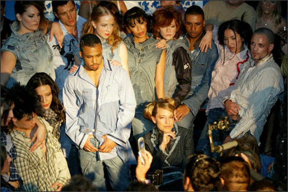 """Models posed for the crowd at the end of the """"Transfigured Denim Collection."""" Neodandi pieces are """"exoskeletal"""" -- there's an inside-out quality to them, with exposed seams and deconstructed shapes, says the designer. Photo: Scott Eklund/Seattle Post-Intelligencer / Seattle Post-Intelligencer"""