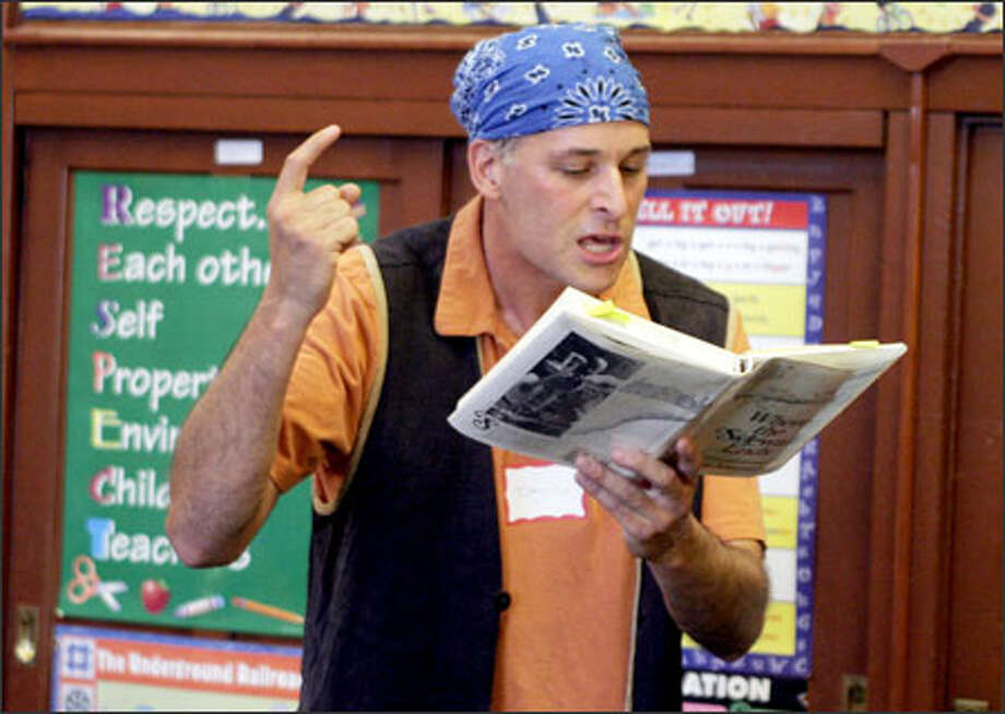 Actor David Natale, a BookPAL volunteer, acts out Captain Hook while reading aloud during Family Reading Circus Night at Seattle's Orca Elementary School. Photo: Meryl Schenker/Seattle Post-Intelligencer