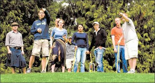 Lakewood Croquet Club members survey their extreme course at Gas Works Park. And it's all downhill from there. Photo: PAUL JOSEPH BROWN/P-I