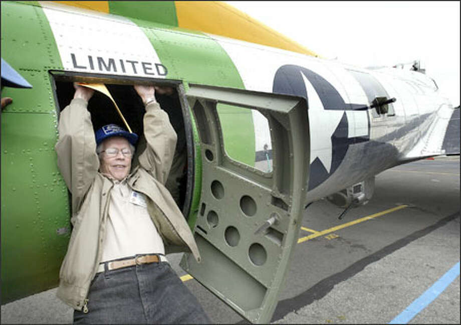 """Veteran B-17 pilot Dick Nelms of Mercer Island slides out of the """"Fuddy Duddy"""" at Boeing Field yesterday, the first time he had flown in a """"Flying Fortress"""" in about 60 years. Photo: Dan DeLong/Seattle Post-Intelligencer"""