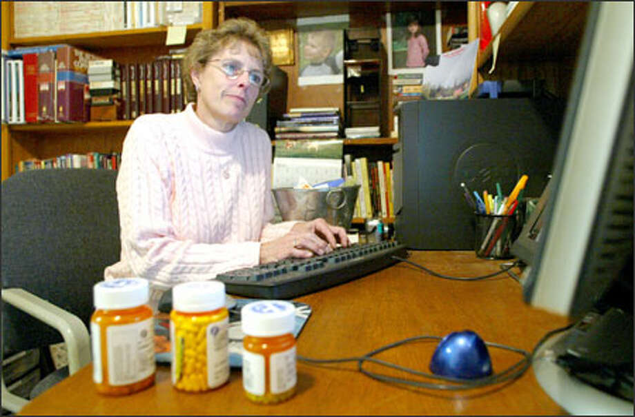 Connie Grimstad of Kent is one of about 10,000 Americans using a free online service that lets people create their own electronic personal health record. Photo: Gilbert W. Arias/Seattle Post-Intelligencer / SEATTLE POST- INTELLIGENCER