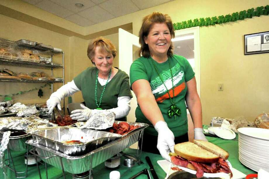 Pat Begler, of New Fairfield, left, and Nancy McKenney, of Danbury, serve corned beef sandwiches in honor of St. Patrick's Day at the Irish Cultural Center in Danbury, Thursday, March 17, 2011. Photo: Michael Duffy / The News-Times