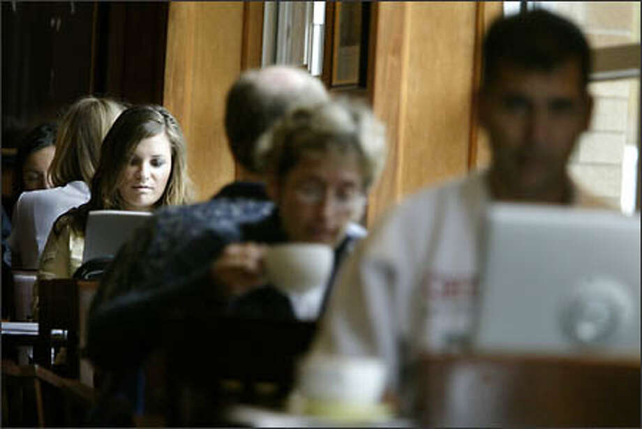 University of Washington student Amanda Whitson joins the crowd taking advantage of the Wi-Fi service at University Zoka. Photo: Dan DeLong/Seattle Post-Intelligencer