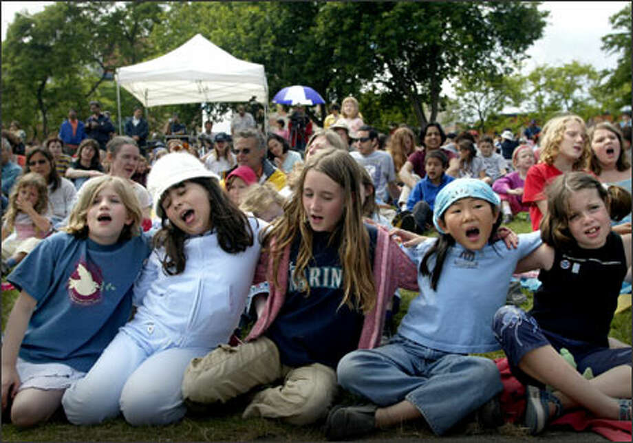From left, Hannah Markus, 8, Bria Kohlberg, 9, Kira Deshler, 9, Alexa Salier, 9, and Rana Uhlman, 8, sing at the Mural Amphitheatre's children's peace concert. Photo: Joshua Trujillo/Seattle Post-Intelligencer / Seattle Post-Intelligencer