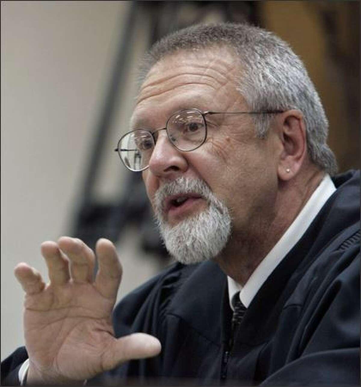 Judge John Bridges announces his verdict in the gubernatorial election challenge in Chelan County Superior Court Monday in Wenatchee. Bridges upheld Washington's 2004 gubernatorial election. (AP Photo/Elaine Thompson)