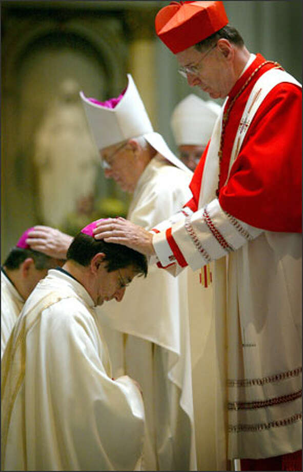 Cardinal Roger Mahony of Los Angeles ordains Rev. Joseph Tyson as bishop in service at Seattle's St. James Cathedral.  Mahoney is stripped of public duties for covering up clerical sex abuse cases.  Yet, he is part of conclave that will pick a successor to Pope Benedict XVI. Photo: Joshua Trujillo/Seattle Post-Intelligencer / Seattle Post-Intelligencer