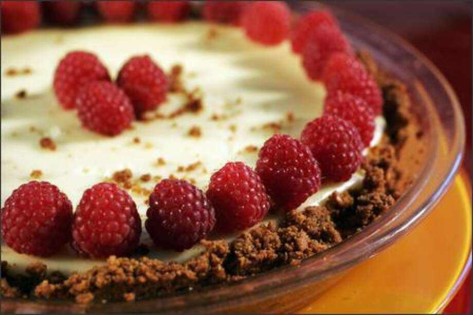 "Lemon Cream Cheese Pie topped with raspberries and using a graham cracker crust is from ""Maida Heatter's Pies & Tarts."" Photo: Meryl Schenker/Seattle Post-Intelligencer"