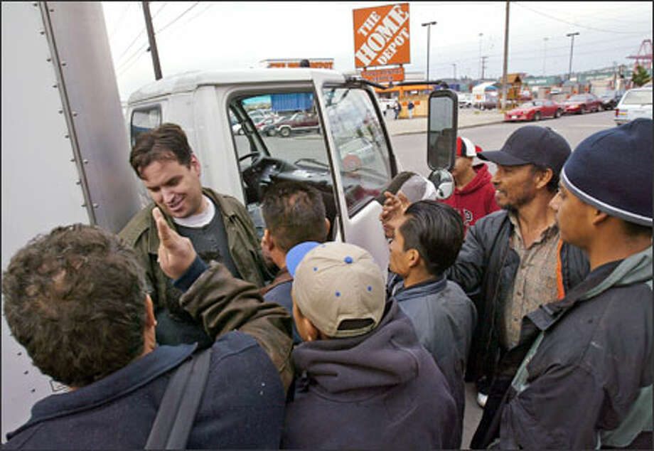 An unidentified contractor has plenty of laborers to choose from near the Home Depot in Sodo. The crowds have become a problem for the store. Photo: Paul Joseph Brown/Seattle Post-Intelligencer