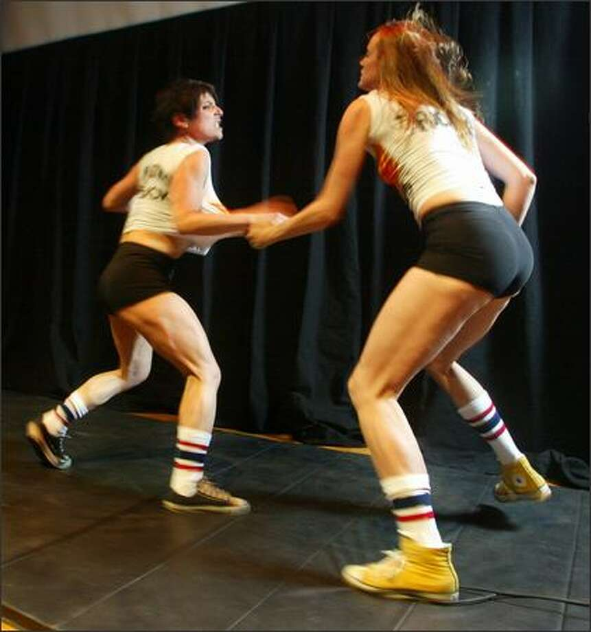 Ellen Forney fights Adrienne Taggart during a sneak preview of their upcoming wrestling match. Photo: Karen Ducey/Seattle Post-Intelligencer