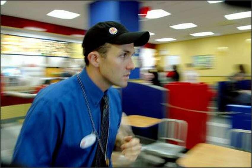 Magna Corp. lawyer Alex hustles at a New York Burger King franchise.