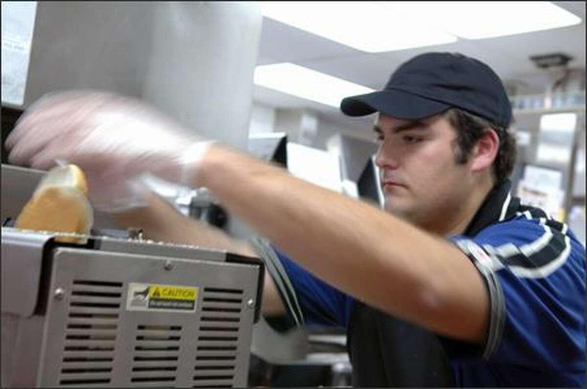 Michael works the bun warmer.