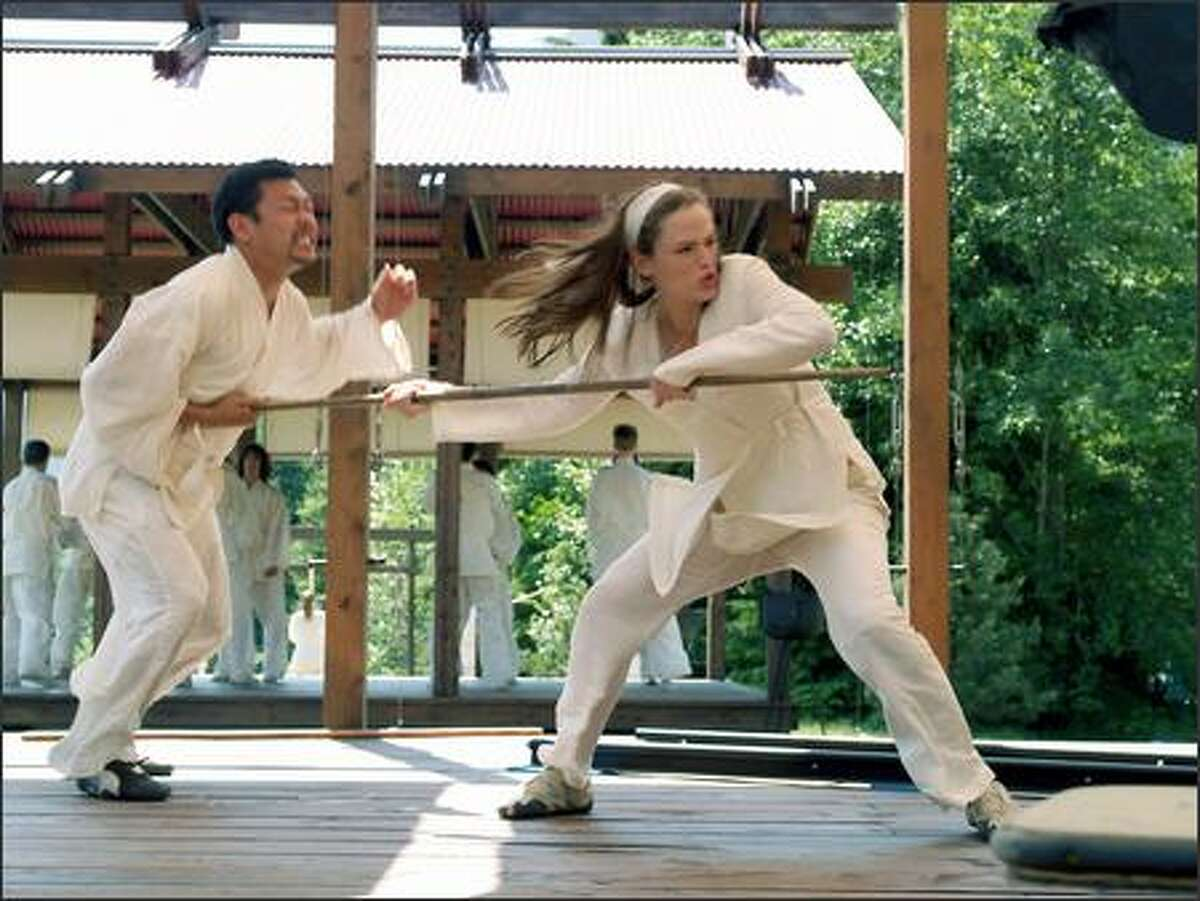 Under the tutelage of the blind martial-arts master Stick (Terrence Stamp), the man who restored her to life, Elektra (Jennifer Garner) has honed her own skills to become unbeatable in physical combat.