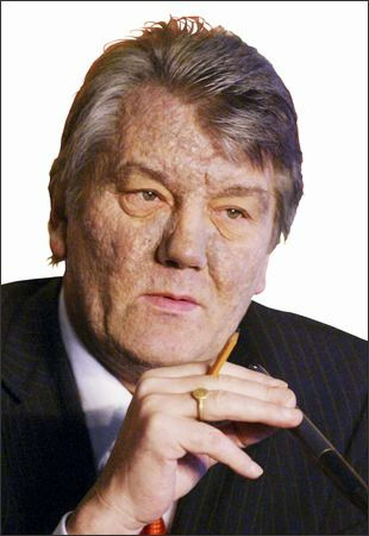 Ukrainian opposition presidential candidate Viktor Yushchenko, speaks to the media during a press conference in Kiev, Ukraine, Thursday, Dec. 16, 2004. Yushchenko said Thursday that he is sure he was poisoned by the Ukrainian government, and for the first time pinpointed the time and place where he believed he was poisoned with dioxin: a Sept. 5 lunch with the head of the Ukrainian security service and his deputy. (AP Photo/Efrem Lukatsky)