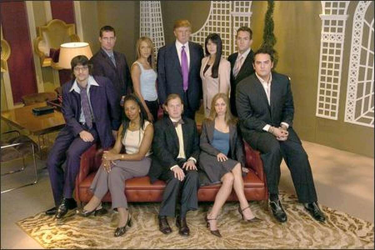 "The ""book-smart"" Magna team: (back row, l-r) Todd, Stephanie, Donald Trump, Erin, Alex; (front row) Danny, Verna, Bren, Kendra, Michael."