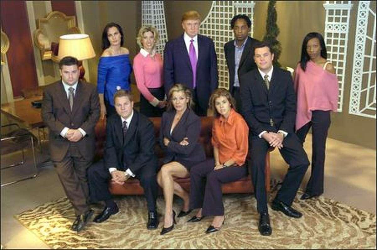 The street-smart Networth team: (back row, l-r) Kristen, Tana, Donald Trump, Craig; (front row) Brian, Chris, Angie, Audrey, John, Tara.