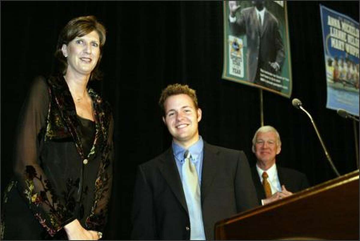 Winners Storm coach Anne Donovan and golfer Ryan Moore at the P-I's Sports Star of the Year banquet. P-I Publisher Roger Oglesby is in the background.