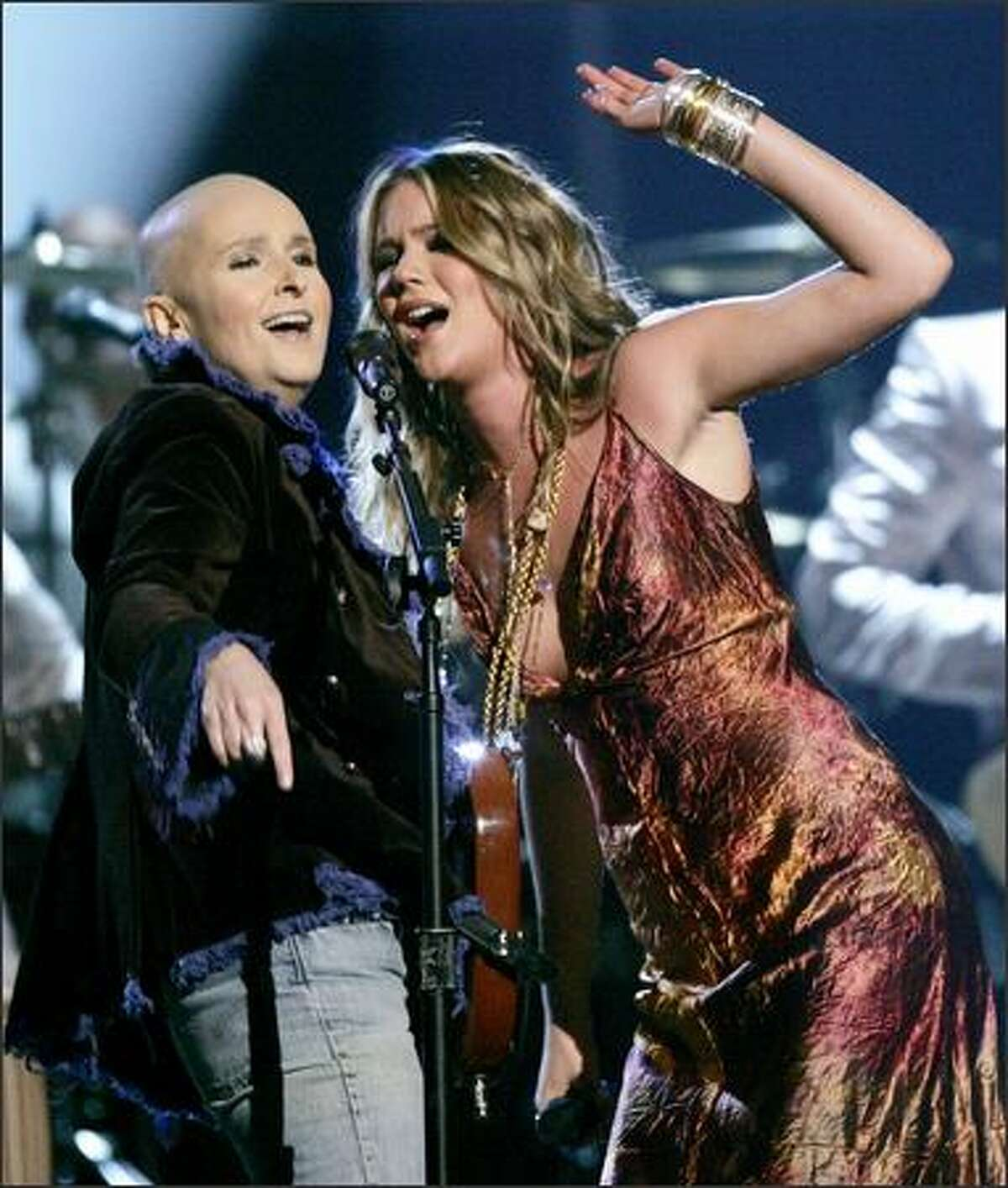 """Joss Stone, right, and Melissa Etheridge perform the medley """"Cry Baby/Piece of My Heart"""" in a tribute to the late Janis Joplin at the 47th Annual Grammy Awards. (AP Photo/Kevork Djansezian)"""
