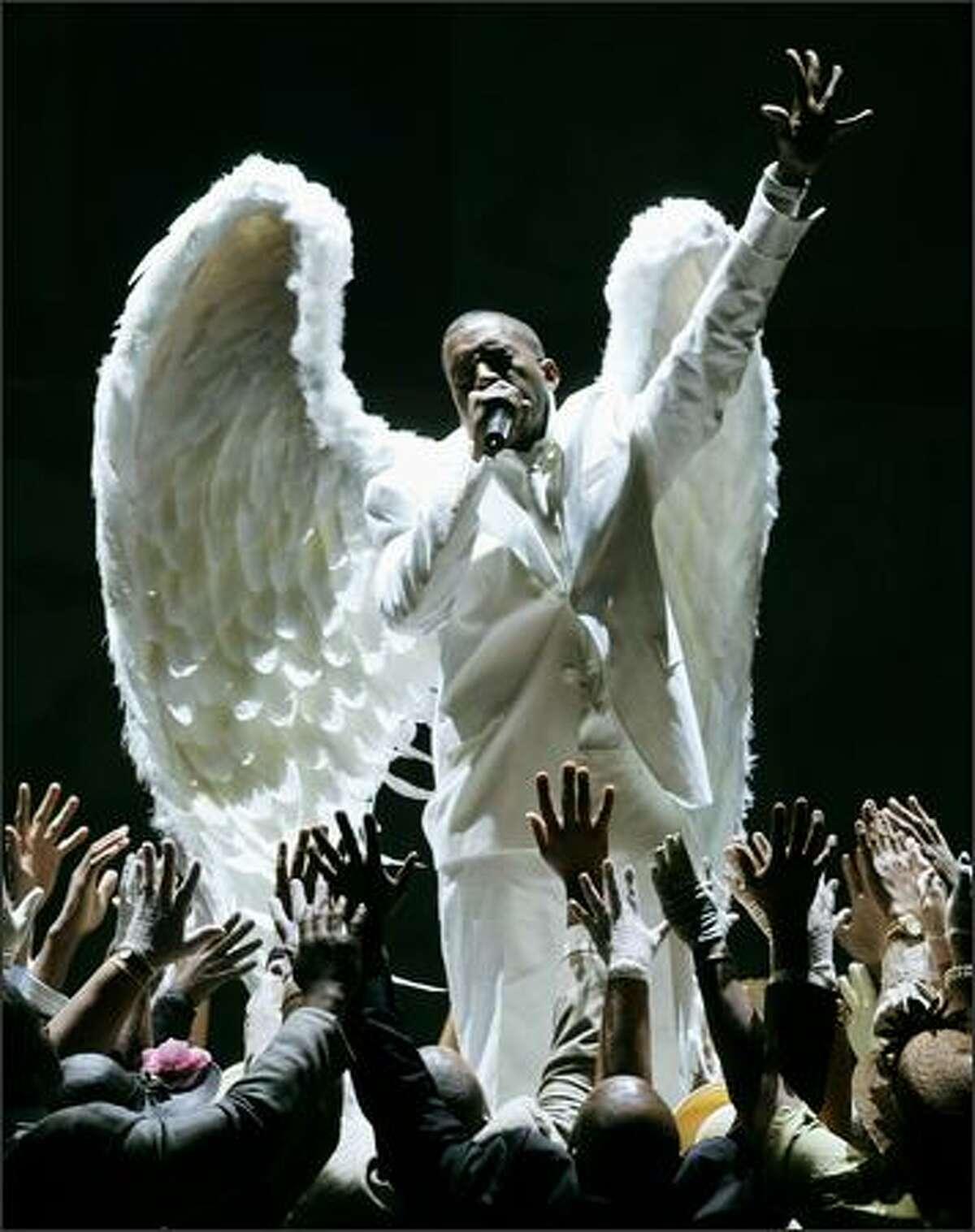 "Kanye West performs ""Jesus Walks"" at the 47th Annual Grammy Awards. (AP Photo/Kevork Djansezian)"