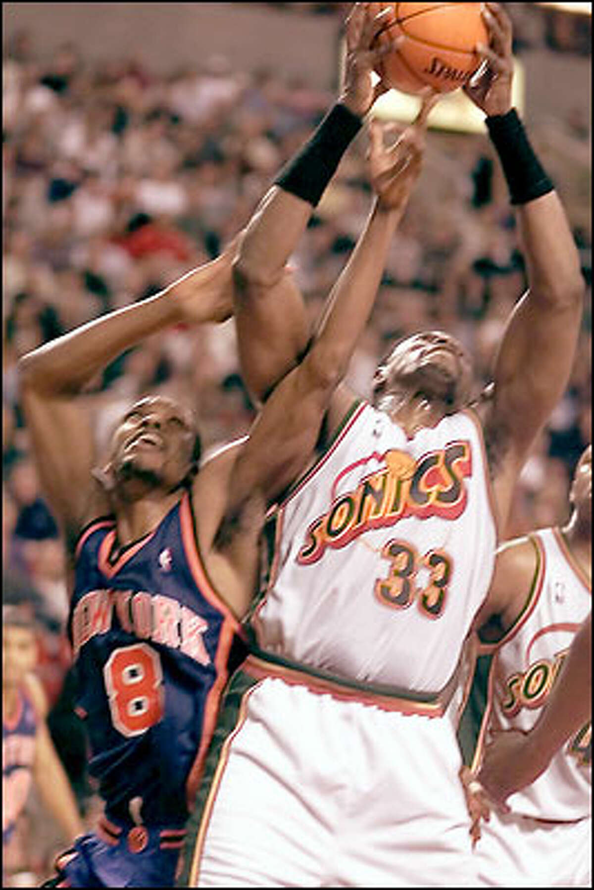 Seattle Supersonics' Patrick Ewing against New York Knicks Latrell Sprewell at Key Arena.