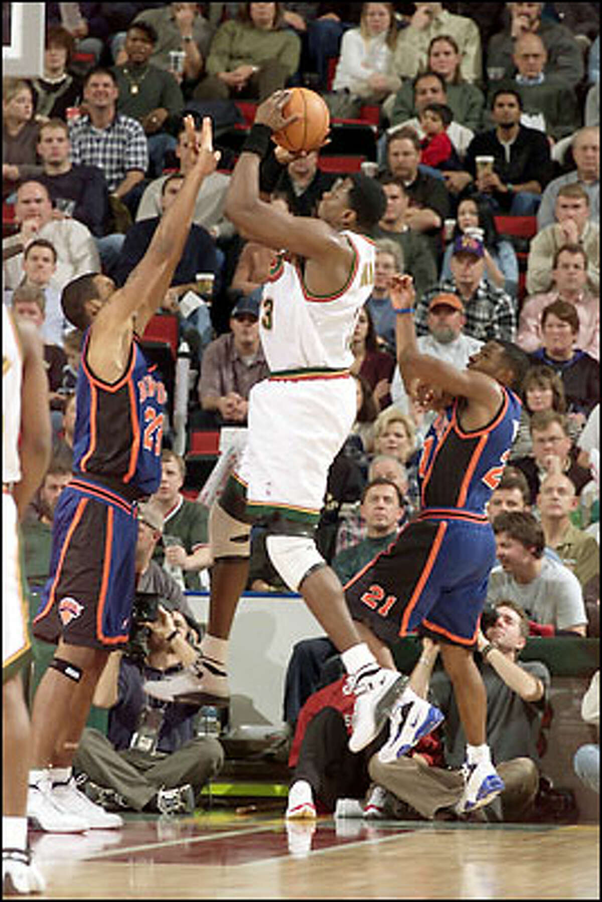 Seattle's Patrick Ewing goes up with New York's Marcus Camby and Charlie Ward in second half action.