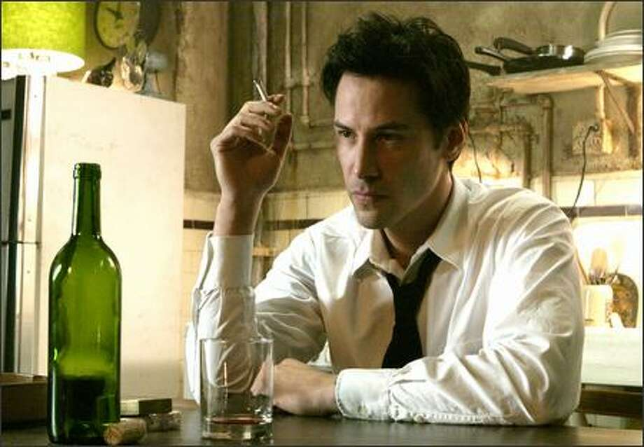 "Keanu Reeves as the very antiheroic John Constantine -- an embittered, hard-living con man and magician who saves others while knowing salvation is closed to him -- in ""Constantine,"" a live-action adaptation of the long-running DC/Vertigo horror comic, ""Hellblazer."" Photo: Warner Brothers"