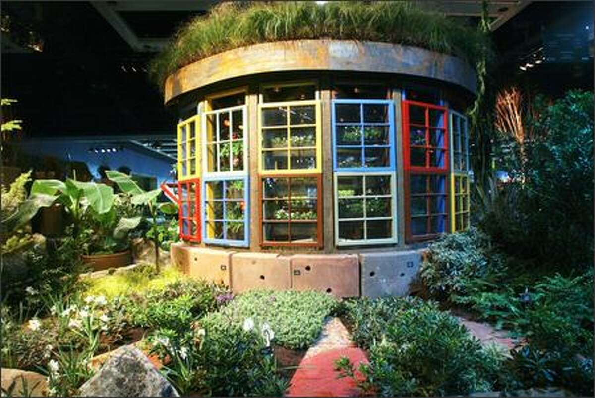 A view of the Seattle P-I and Seattle Tilth display garden at the Northwest Flower and Garden Show titled
