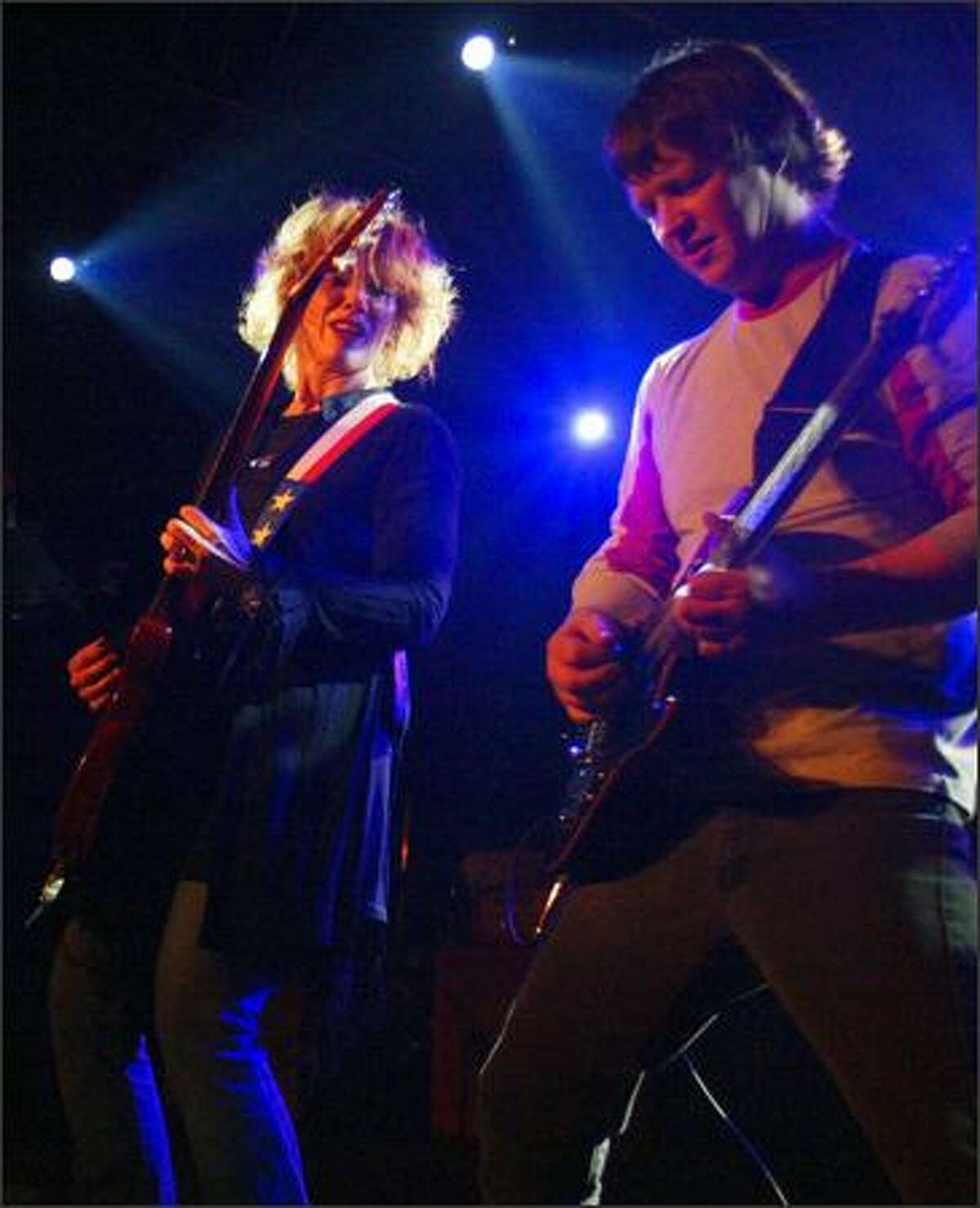 Nancy Wilson of Heart, left, cranks out another tune at the K-Rock Tsunami Continued Care Relief Concert at Premier.