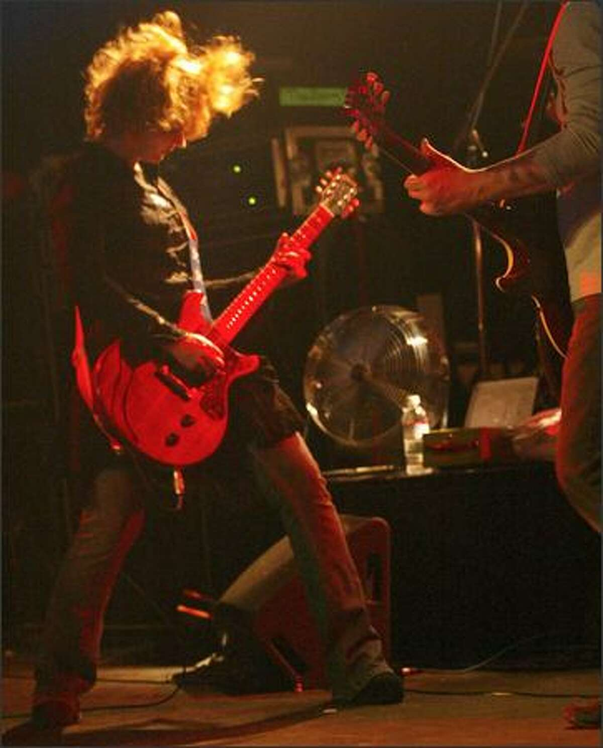 Nancy Wilson of Heart, left, sings a Led Zeppelin cover at the K-Rock Tsunami Continued Care Relief Concert at Premier.
