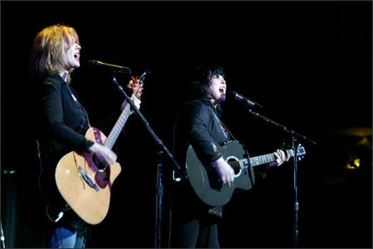 Ann (right) and Nancy Wilson perform a rock chestnut in Friday's benefit concert for the Northwest School.