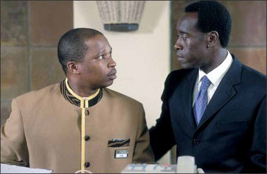 "Don Cheadle (right) stars in ""Hotel Rwanda,"" a true story about internal strife in the African nation in the 1990s. Photo: United Artists"