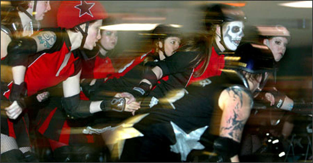 The Rat City Rollergirls opened their 2005 season at Southgate Roller Rink in White Center working the jam and trying to knock each other down.