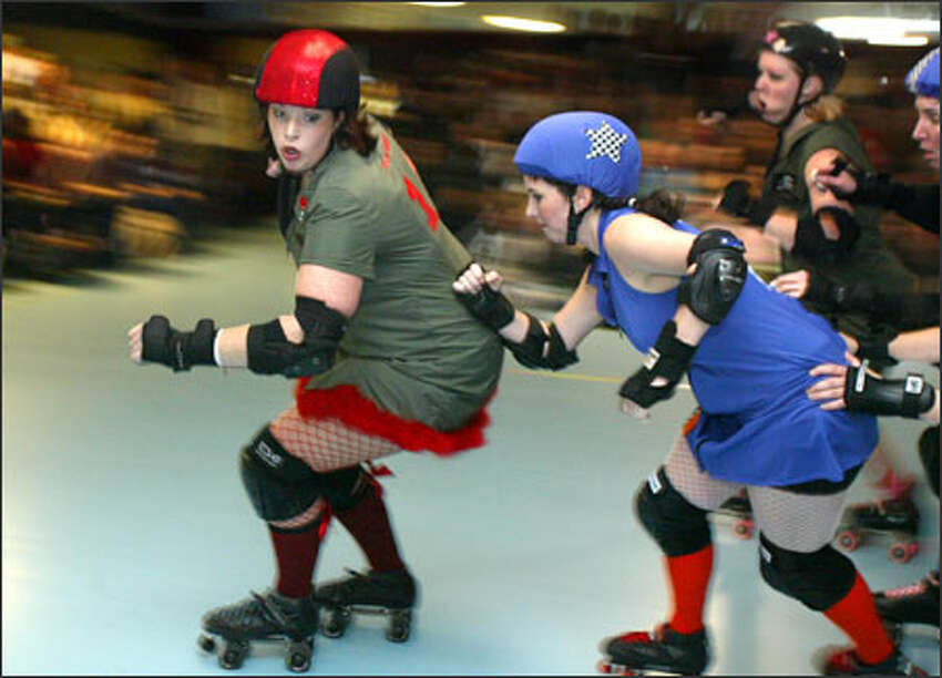 Skaters from the Derby Liberation Front in green and red compete against the Sockit Wenches in blue. The teams take each other on once a month.