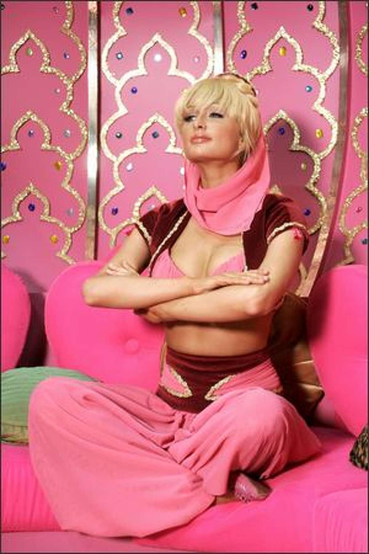 Paris Hilton channels Jeannie the genie when she plays