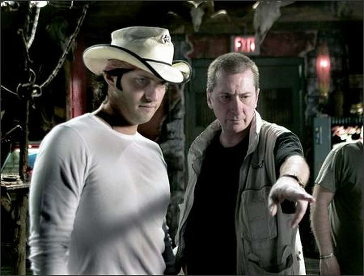 The film was co-directed by Miller (right) and Robert Rodriguez, with