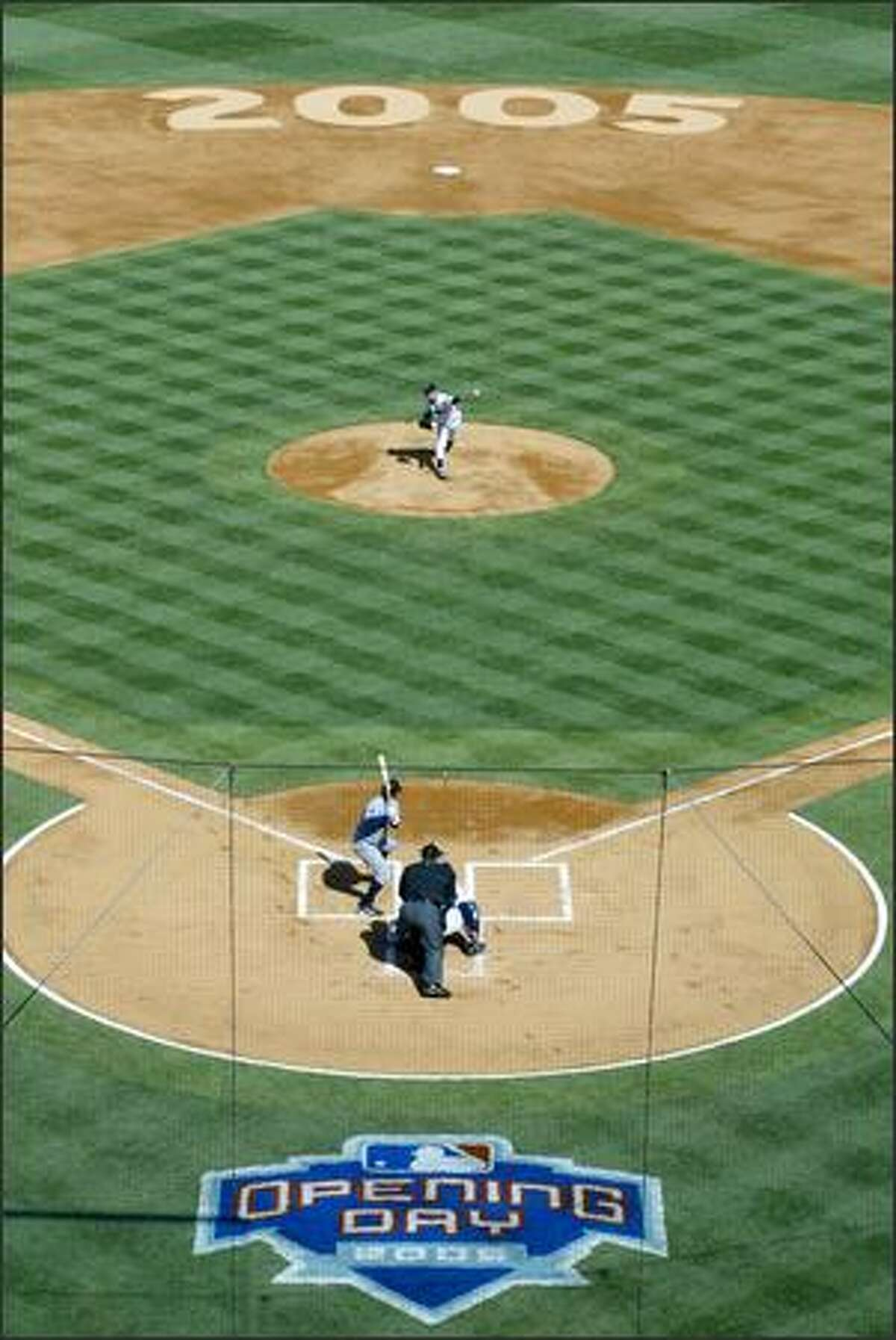 Mariners pitcher Jamie Moyer throws his first pitch against the Twins.