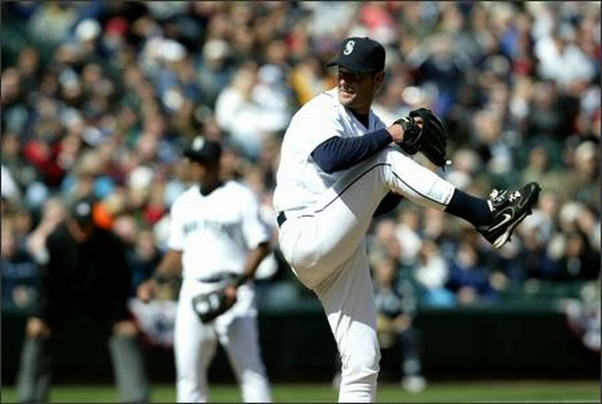 Mariners' starter Jamie Moyer winds up the first pitch of the game at opening day against the Minnesota Twins.