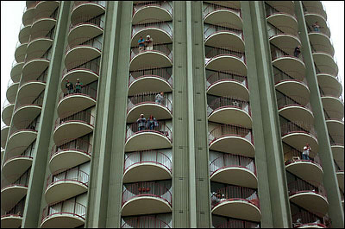 Some residents of 21st Century Apartments watched the marchers from on high as they made their way down Pine Street downtown.
