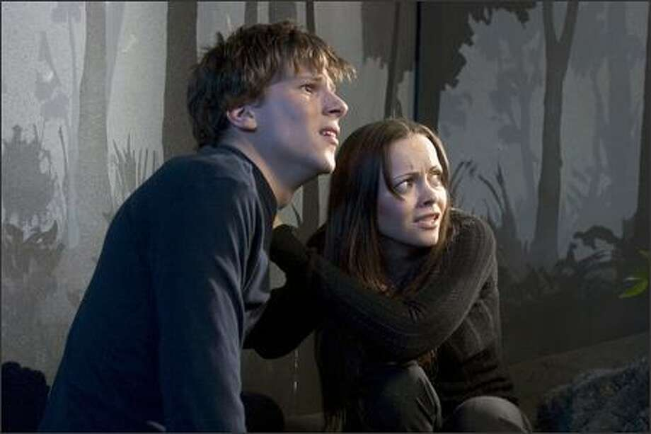On a moonlit night in Los Angeles, something darting out of the shadows causes siblings Ellie (Christina Ricci, right) and Jimmy (Jesse Eisenberg) to suddenly swerve their car off the road and plunge into a ravine. They escape with their lives, but are forever changed by the accident. Photo: Dimension Films