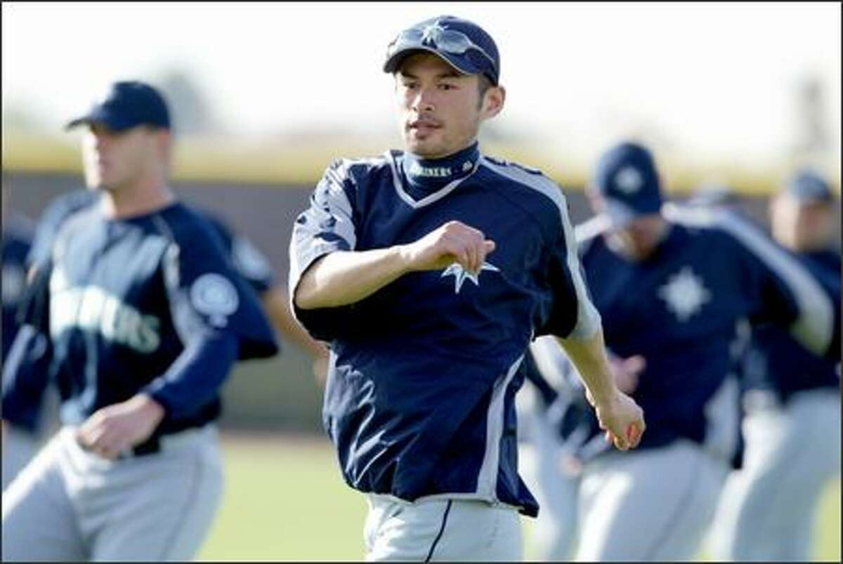 Ichiro Suzuki warms up at the beginning of the Tuesday's workout.